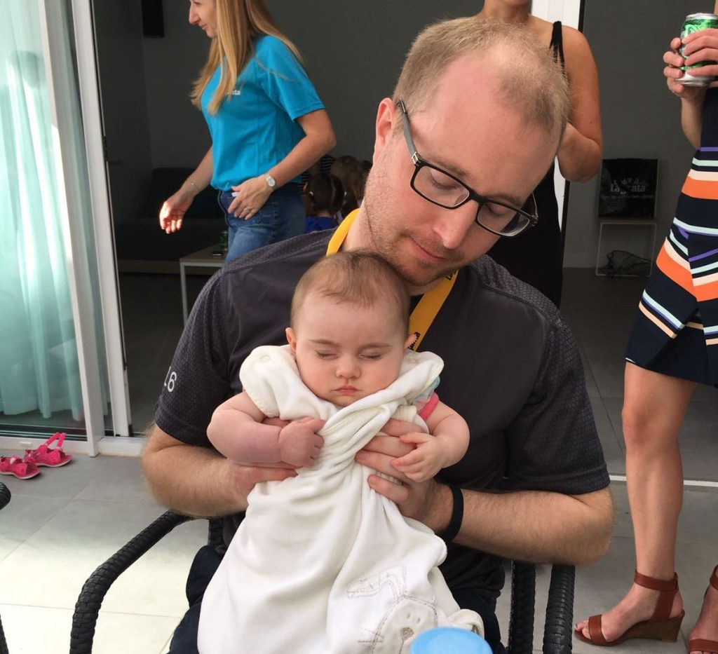 "Attempting to ""impress with baby handling skills""!"